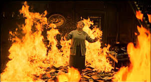 The famous scene in the movie version of «Fahrenheit 451», in which a bibliophile prefers to go down with her books.